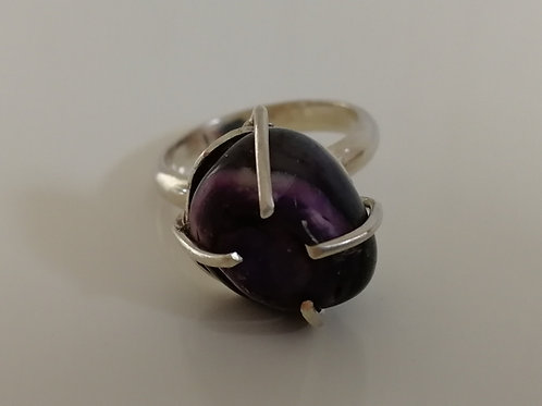 Sterling silver ring with a raw purple stone
