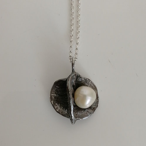 Blackened sterling silver apple cone pendant with a freshwater pearl and a chain