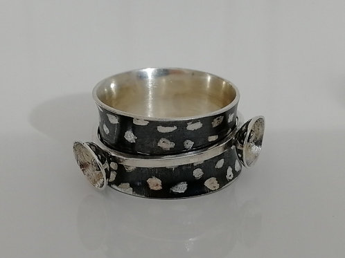 Blackened sterling silver alien ring with a spinner