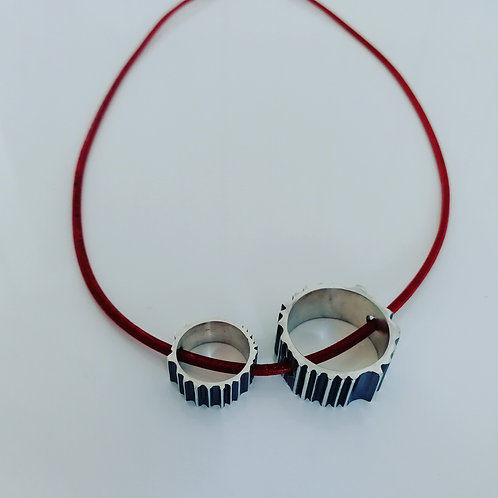 Necklace with two sterling silver circles and red leather cord