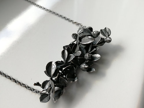Blackened sterling silver bush pendant with a chain