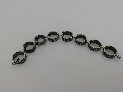 Solid blackened sterling silver bracelet with circles