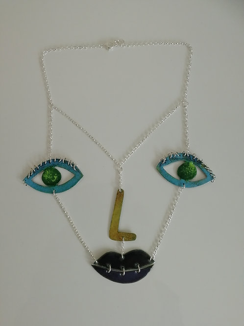 Double sided enameled sterling silver face necklace