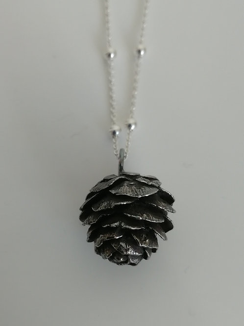 Solid sterling silver cone pendant with a chain