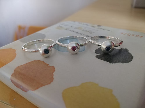 A set of 3 stackable sterling silver rings with CZ