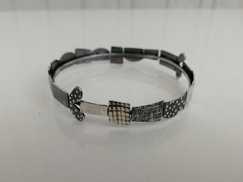Solid sterling silver art bangle