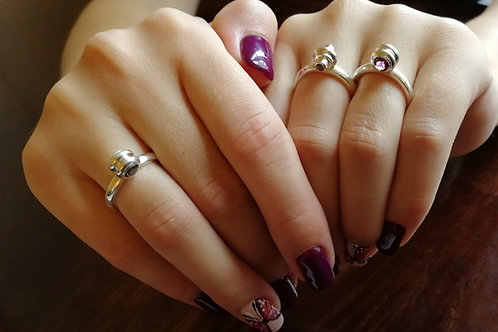 A set of 3 stackable sterling silver 925 rings with precious stones