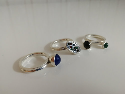 A set of 3 stackable sterling silver rings with moving round gemstone spheres