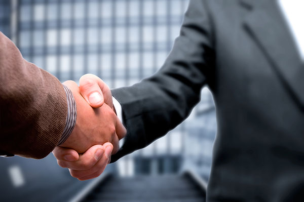 buisness men shake hands