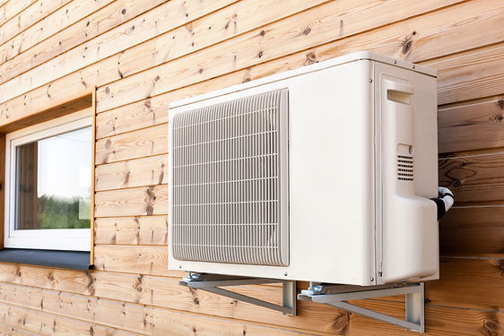 Exterior airconditioning unit on a woode