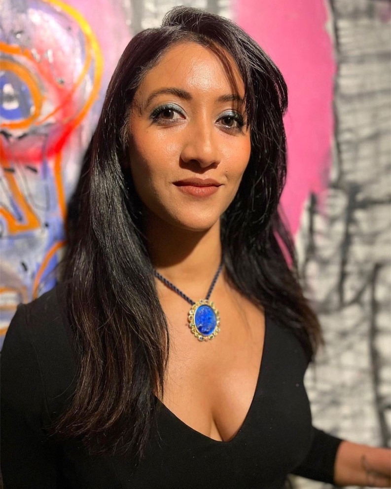 Priya Darshini wearing Mejia Jewelry's Venetian glass cameo necklace