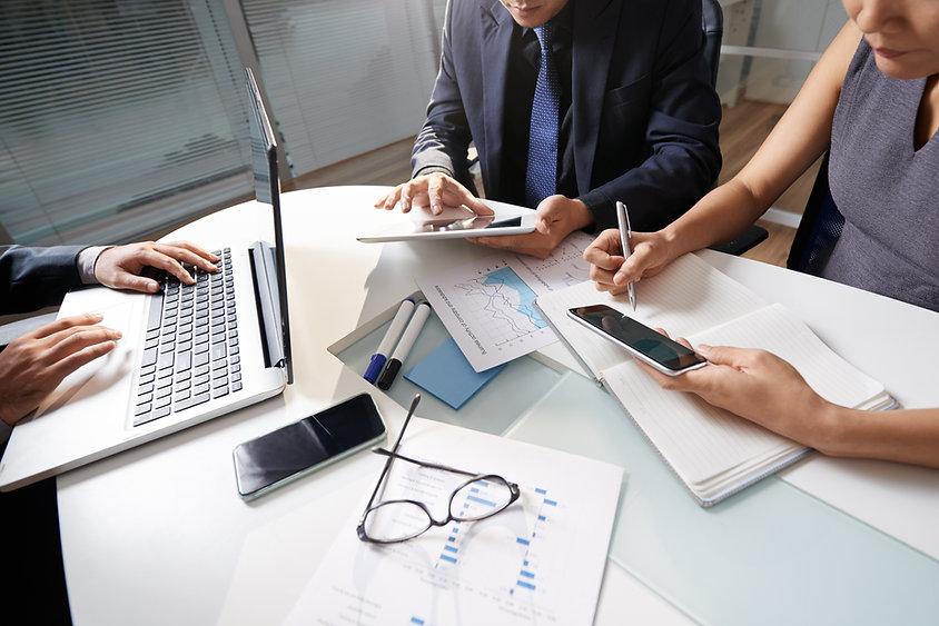 business-people-sitting-office-desk-work