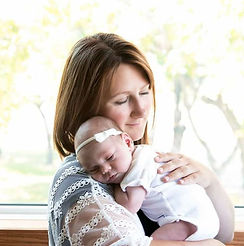 Lindsey, the owner of E-Motion Therapy, with her second baby girl.