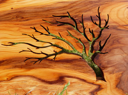 Blowing tree silhouette sculpture on yew wood