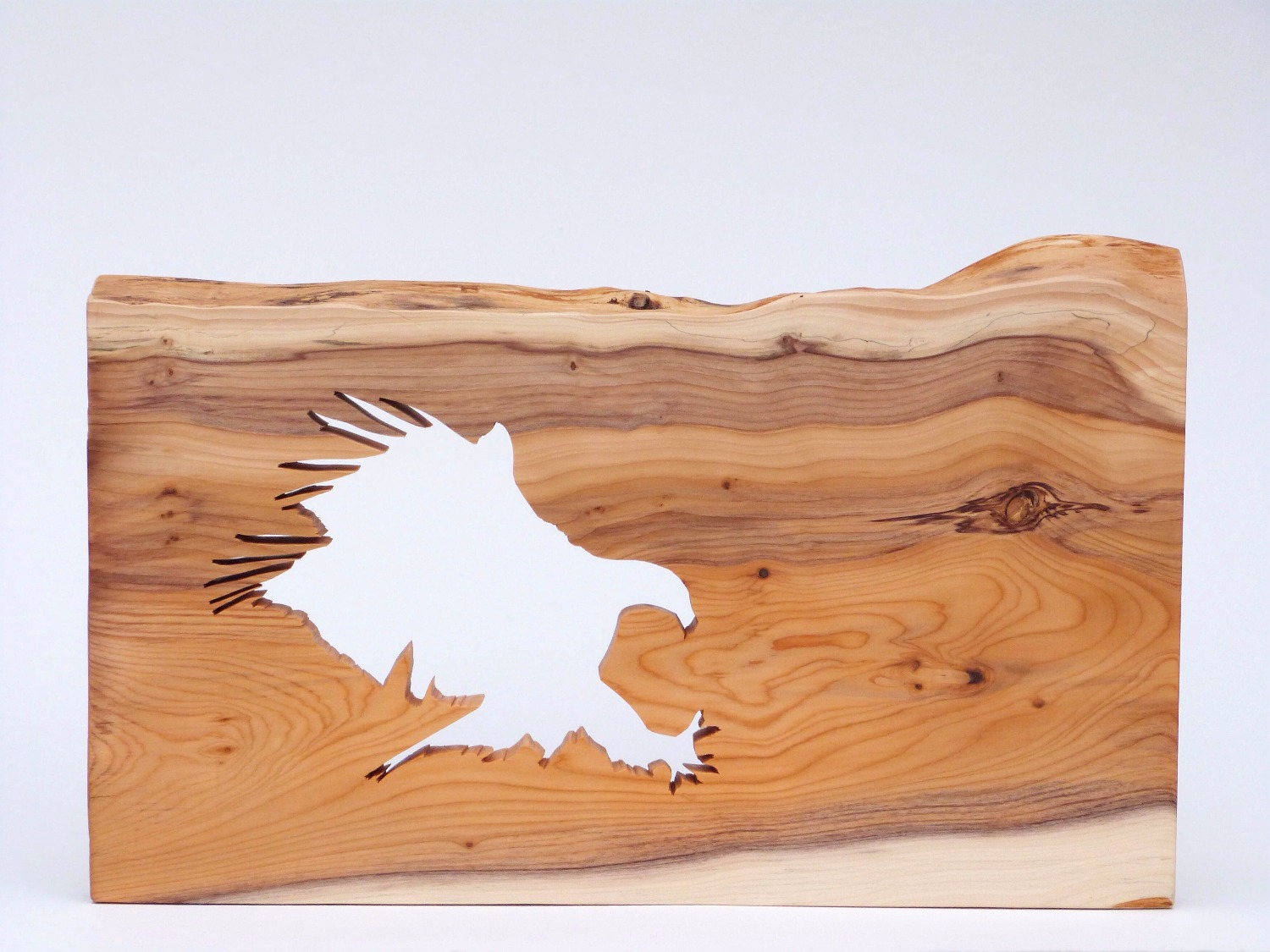 Eagle silhouette sculpture on yew wood
