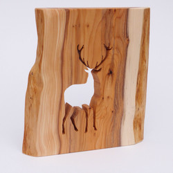 Yew stag silhouette sculpture