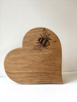Hand burnt bee on Oak heart