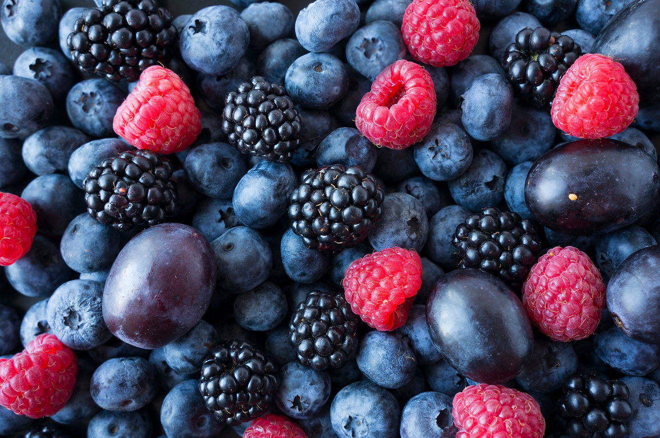 Background of fresh fruits and berries.