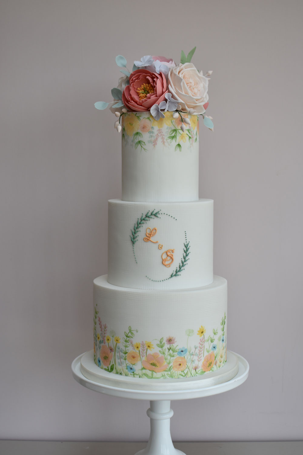 3 tiered wedding cake with sugar paste flowers and hand painted florals by Bake My Cake