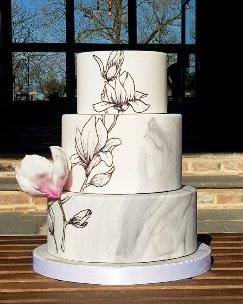 Magnolia outline hand painted details on marble 3 tiered cake by H.S. Cake Design