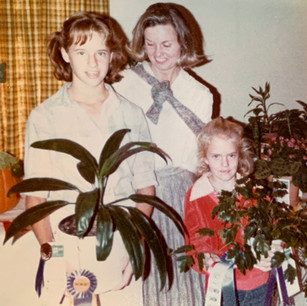 Current Member, Sally Young with Her Daughters at the DGC Flower Show 1979