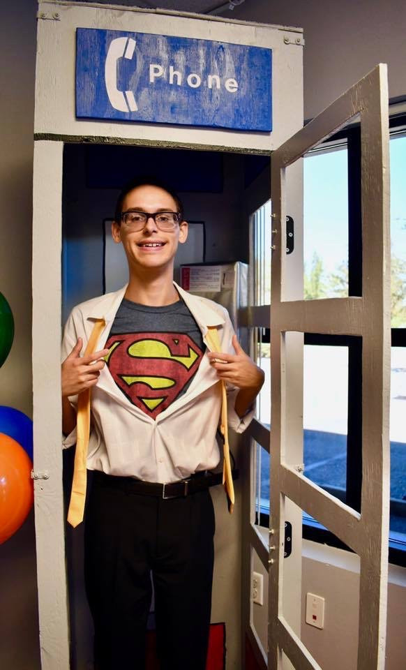 Eli NeSmith shows off his Superman abilities at the groundbreaking event.