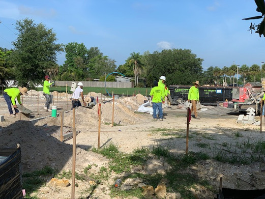 Workers begin on the grounds of the new center.