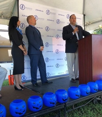 Rep. Ray Rodrigues speaks to attendees at the groundbreaking about the importance of Family Initiative's work with the autism community.