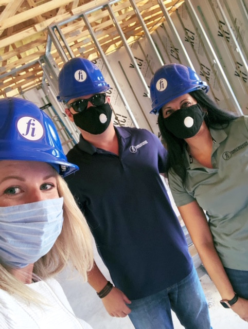 Jenna Persons tours the inside of the building under construction with David and Anjali.