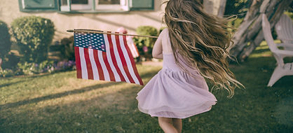 Girl Waving US Flag