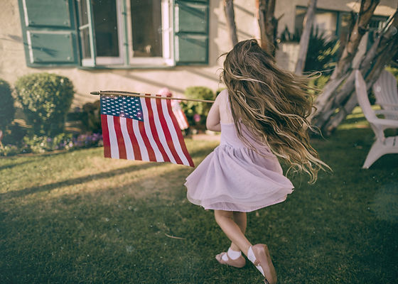 Girl Waving US Flag
