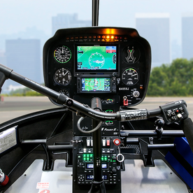 R44 Raven II Instrument Panel and cyclic (shown with optional avionics)