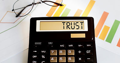 calculator with the word TRUST on displa