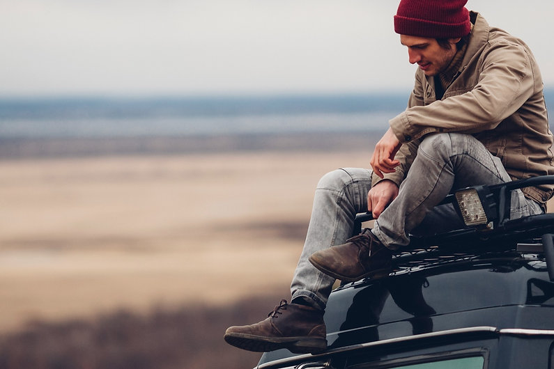 Guy Sitting on Car_edited_edited_edited.jpg