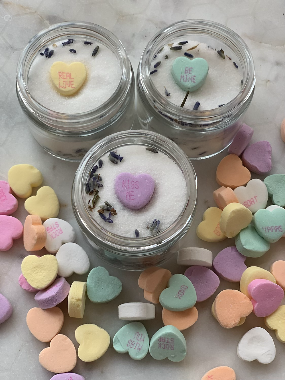 homemde sugar scrub for clean healthy skin with dried lavender buds and valentine candies