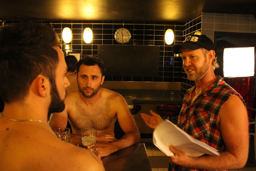 The director discussing the bar scene with Liam and David