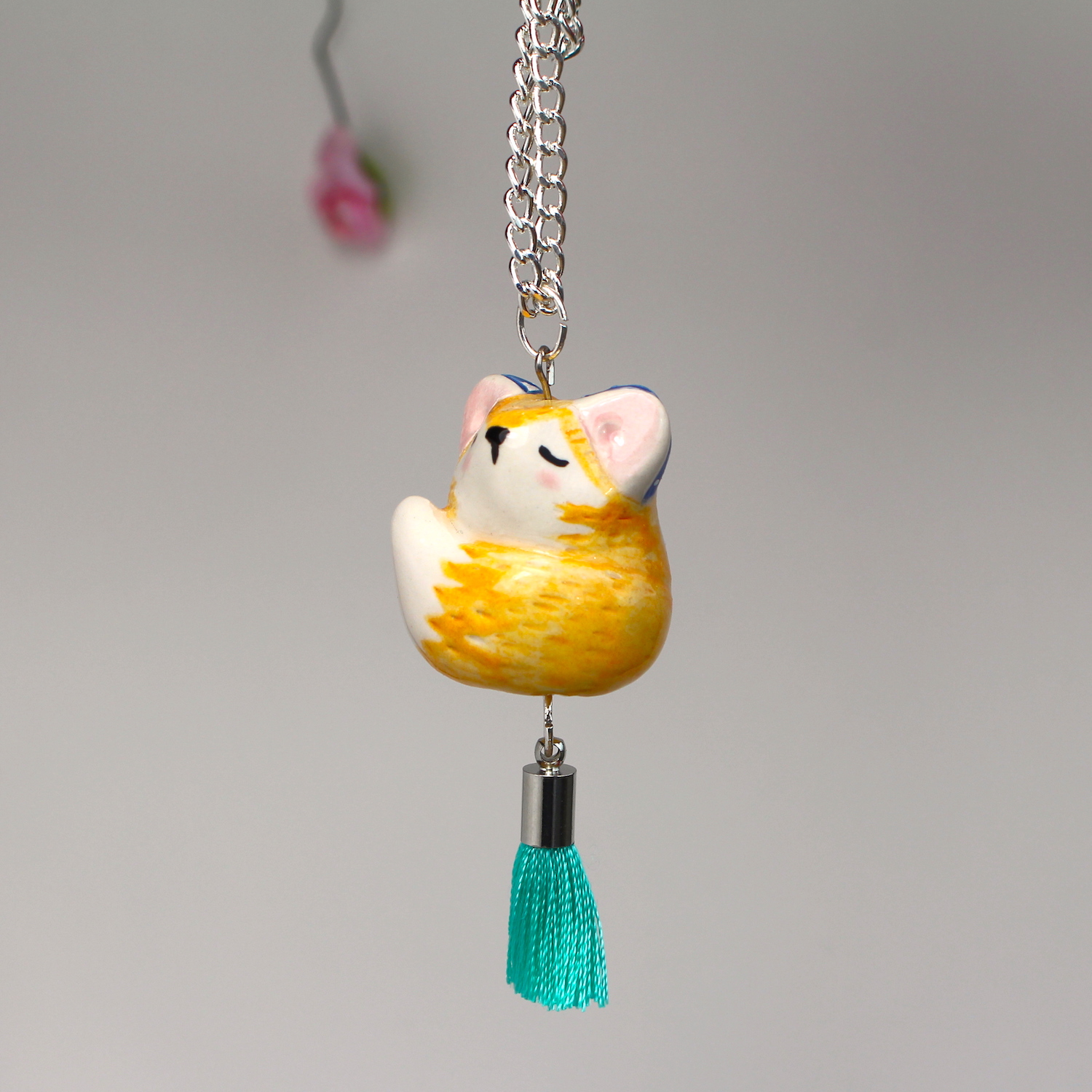 FOX NECKLACE WITH MINT GREEN TASSEL.