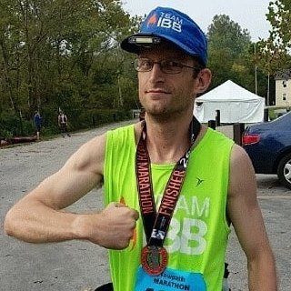 Picture of Fenell flexing for the camera after running the Towpath Marathon in Northeast, Ohio