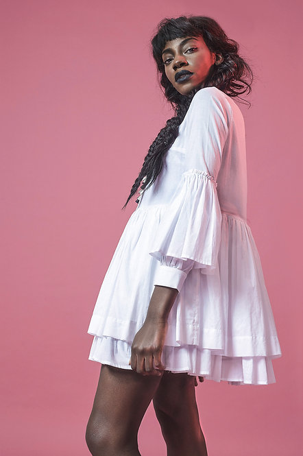 Side view of loose fitted dress with gathering and frills