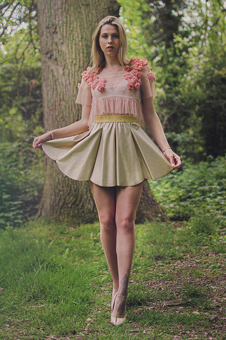 Editorial of a model wearing lux handmade outfit featuring gold and pink
