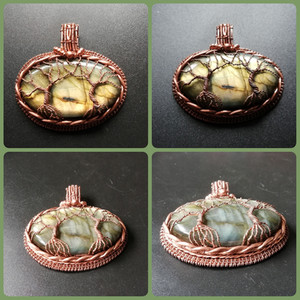 A spectacular, golden labradorite wrapped in copper and adorned with 2 trees of life