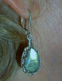 Labradorite set in sterling silver, hanging from lever back ear hooks.