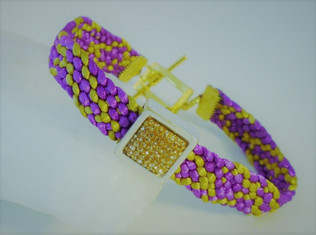 Woven bracelet in silky cord with a sparkly rhinestone embelishment