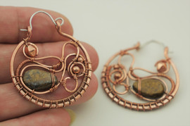 Copper hoops with sterling silver ear hooks.