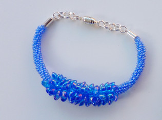 Woven, beaded bracelet
