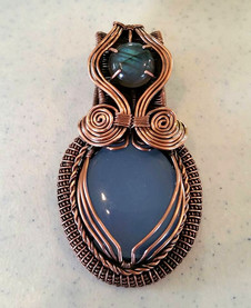 Blue chalcedony and labradorite wrapped in antiqued copper.