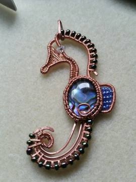 Paua shell is the body of this copper sea horse.