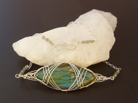 A stunning labradorite marquise wrapped in sterling silver, with labradorite rondelles on the chain.