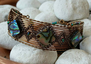 Antique bronze cuff bracelet with paua shell squares.