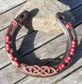 A shoe worn by my own horse. Copper with red agate and red howlite.